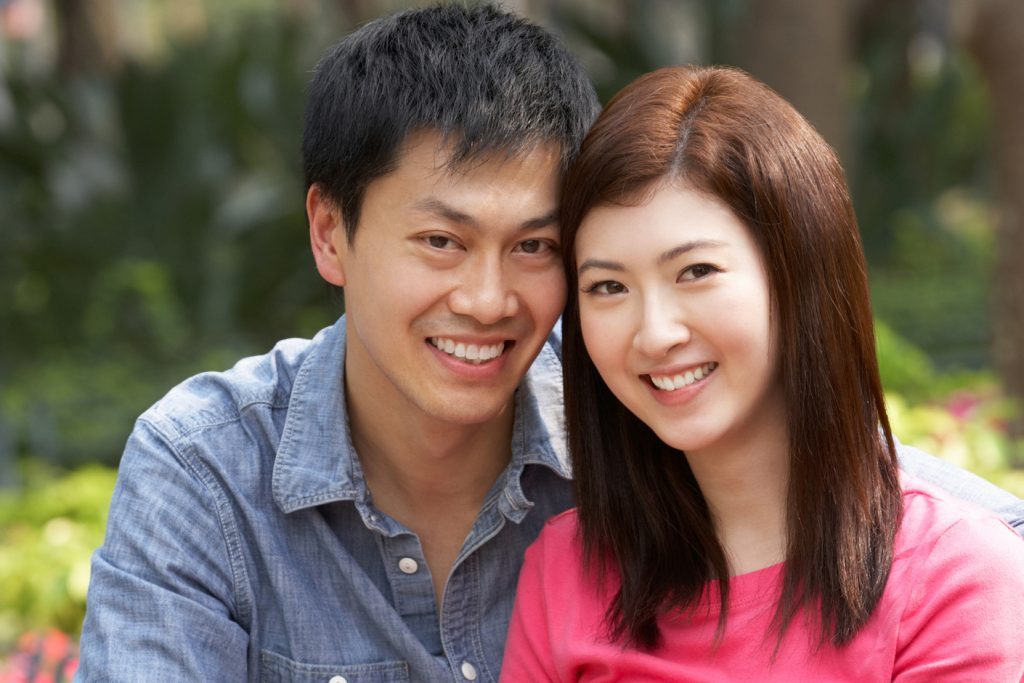 smiling young Asian couple